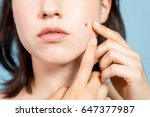 young woman who checks her skin.... | Shutterstock . vector #647377987