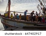 Small photo of PRACHUAP KHIRI KHAN THAILAND-MARCH29,2017:worker on fishery boat approaching for located fresh fish to port of klong wan ,after seeking over last night in prachaup khiri khan southern of thailand