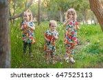 three girls with dandelions | Shutterstock . vector #647525113