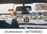 man driving car using navigator ... | Shutterstock . vector #647548003