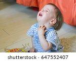 little boy sitting on the floor ... | Shutterstock . vector #647552407