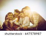 happy family playing outdoor.... | Shutterstock . vector #647578987