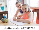 a cute teen girl doing homework ... | Shutterstock . vector #647581237