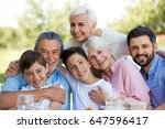 family sitting at table... | Shutterstock . vector #647596417