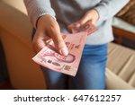 women in room giving thai baht...   Shutterstock . vector #647612257