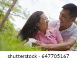 chinese couple playing with... | Shutterstock . vector #647705167