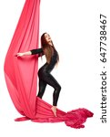 Small photo of Woman girl gymnast acrobat practicing aerial air yoga acrobatics in studio isolated
