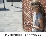 young girl using smartphone... | Shutterstock . vector #647790313