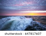 a wake of a motorboat at sunset ... | Shutterstock . vector #647817607