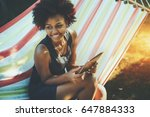 laughing young cute afro... | Shutterstock . vector #647884333