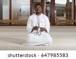 humble african muslim prayer | Shutterstock . vector #647985583