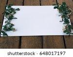 spiraea branches on white sheet | Shutterstock . vector #648017197