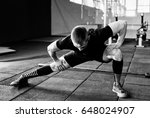 young man preparing muscles... | Shutterstock . vector #648024907