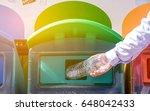 selective focus hand throwing... | Shutterstock . vector #648042433
