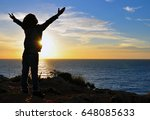 silhouette of a kid with raised ... | Shutterstock . vector #648085633