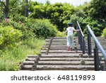 Little Girl Going Up The Stairs