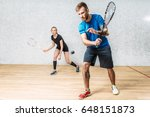 couple with squash rackets ... | Shutterstock . vector #648151873
