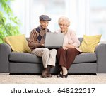 seniors sitting on a sofa and... | Shutterstock . vector #648222517