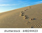 Footprints On A Sand With...