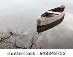 Lonely Row Boat At Lake With...