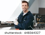 auto mechanic with tools in car ... | Shutterstock . vector #648364327