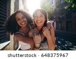 portrait of two young women on... | Shutterstock . vector #648375967