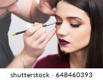 cool male make up artist paints ...   Shutterstock . vector #648460393