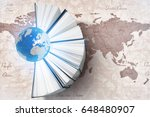 globe with books and world map... | Shutterstock . vector #648480907
