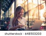 asian woman shopping online...   Shutterstock . vector #648503203