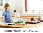 adorable child making cookies | Shutterstock . vector #648547867