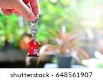 holding house key for concept...   Shutterstock . vector #648561907