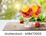 flavored water with fresh... | Shutterstock . vector #648673003