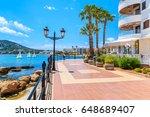 Small photo of Coastal promenade along sea in Santa Eularia town, Ibiza island, Spain