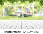 empty wooden table with party... | Shutterstock . vector #648694843