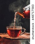 Stock photo process brewing tea tea ceremony cup of freshly brewed black tea warm soft light darker background 648717583