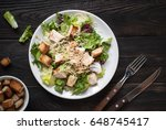 fresh caesar salad in white... | Shutterstock . vector #648745417
