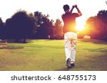 back view of male golfer... | Shutterstock . vector #648755173