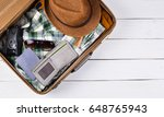 open tourist suitcase with... | Shutterstock . vector #648765943