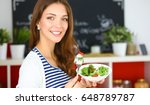 young woman eating salad and...   Shutterstock . vector #648789787