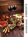 italian antipasti wine snacks... | Shutterstock . vector #648803473