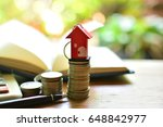 key house on top coins saving... | Shutterstock . vector #648842977