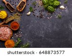 spices and herbs over black...   Shutterstock . vector #648873577