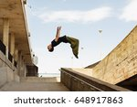 young man back flip. parkour in ... | Shutterstock . vector #648917863