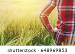 female farmer looking at the... | Shutterstock . vector #648969853