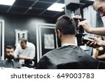 master cuts hair and beard of... | Shutterstock . vector #649003783