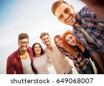 group of young people standing... | Shutterstock . vector #649068007