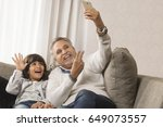 happy grandfather and grandson... | Shutterstock . vector #649073557