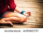 woman hand in yoga symbolic... | Shutterstock . vector #649083757