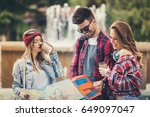 young friends tourists with map ... | Shutterstock . vector #649097047