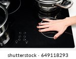 female hand turns on electric... | Shutterstock . vector #649118293